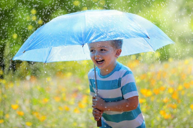 smiling_boy_rain.jpg