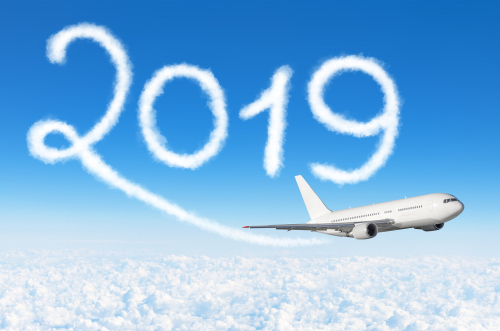 Happy New year 2019 concept travel. Drawing by passenger airplane vapor contrail in sky