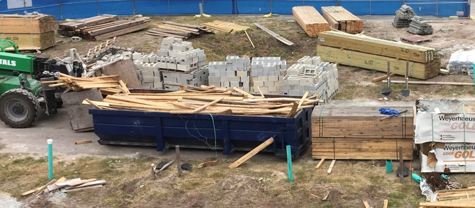 lumber waste in dumpster