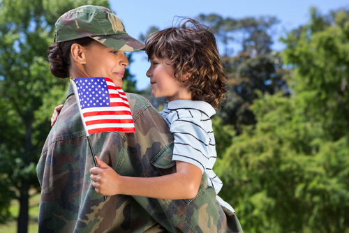 Soldier reunited with her son on a sunny day