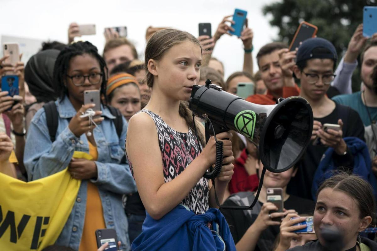 Greta Thunberg and young supporters protest the failure of COP25 and Davos