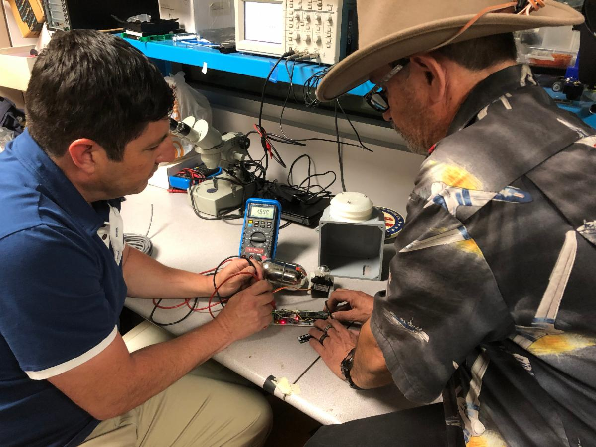 Faculty at ELAC working on the weather station network