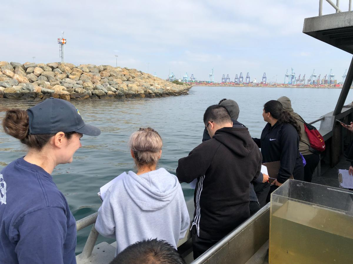 Students prepare to bring up the trawl.