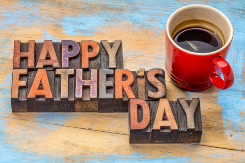 happy father s day in vintage wood letterpress printing blocks with a cup of coffee