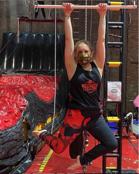 woman hanging red leggings