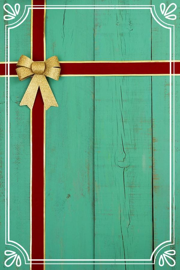 Antique teal blue background with red Christmas bow and ribbon