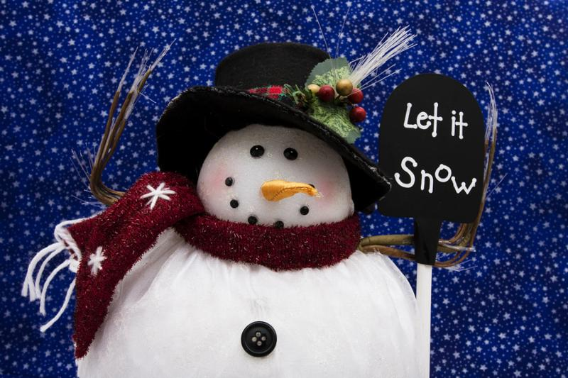 Snowman holding sign with a star background