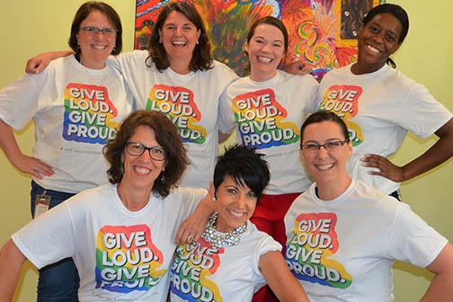 Our staff wearing Give Loud. Give Proud t-shirts