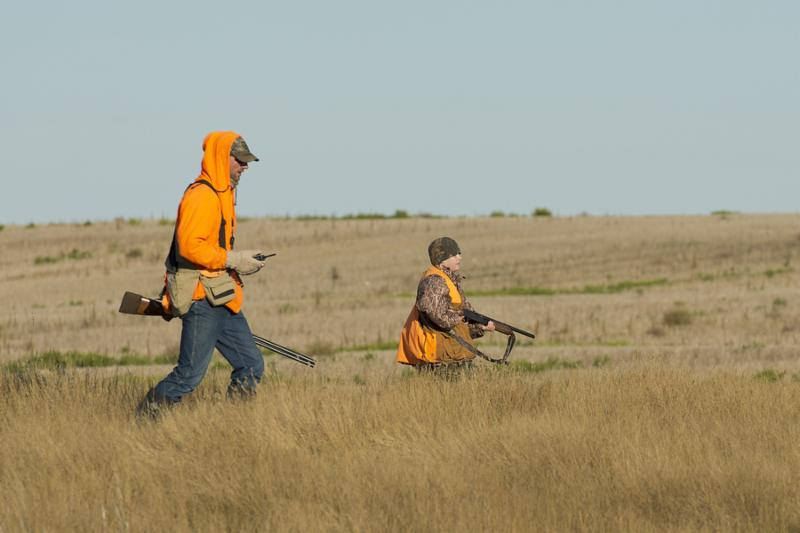 Father and son out pheasant hunting in North Dakota