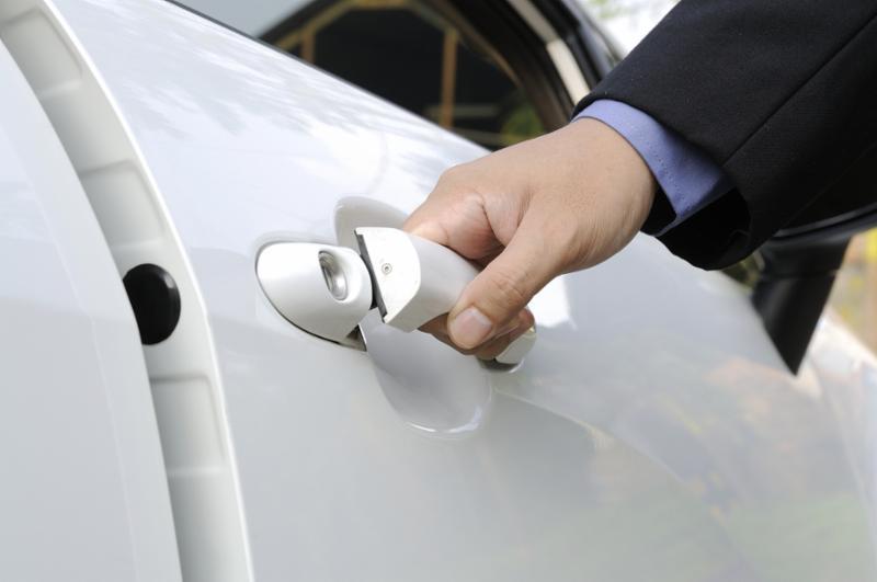 opening_white_car_door.jpg