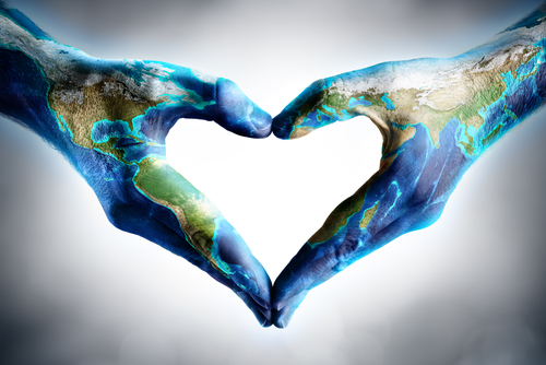 earth s day celebration - hands shaped heart with world map - elements of this image furnished by NASA