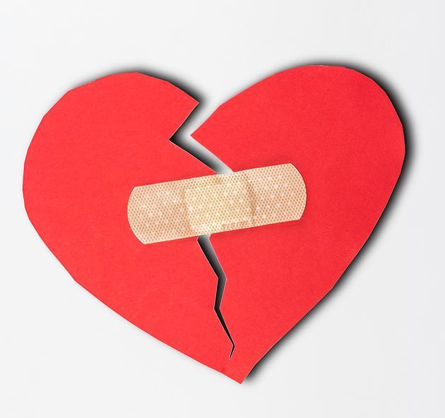 Broken heart shape of red paper for love theme on Valentine concept. Heart paper, heart shape, heart of love, heart background, heart texture, broken love, broken heart and heart elements for love concept design.
