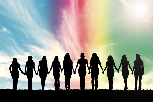 Silhouette of ten young women_ walking hand in hand under a rainbow sky.