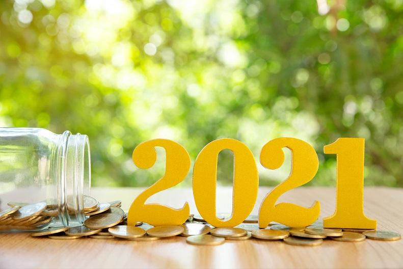 Coins falling out of a jar with the year 2021 in front