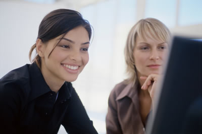 Photo of women at computer