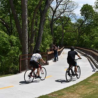 Photos of cyclists on new trail bridge