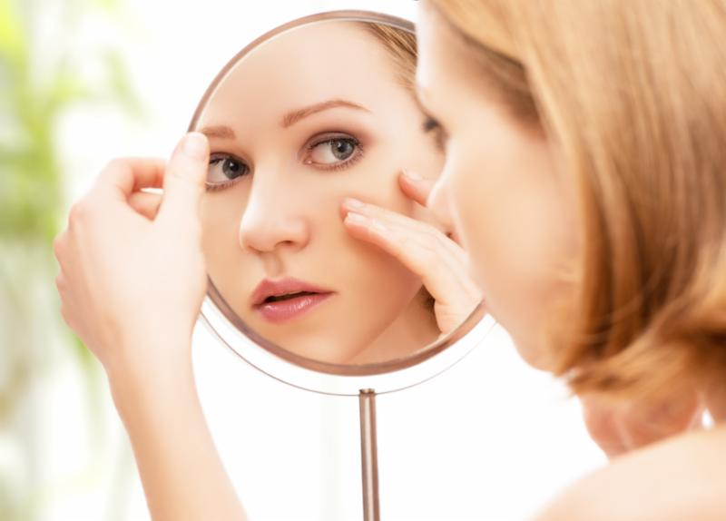 woman_looking_face_mirror.jpg