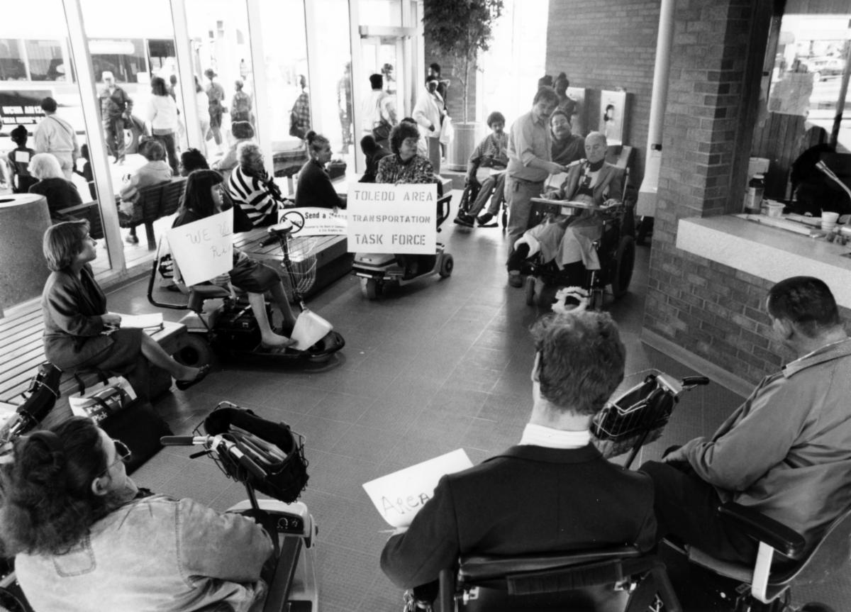 Image of people at a sit in