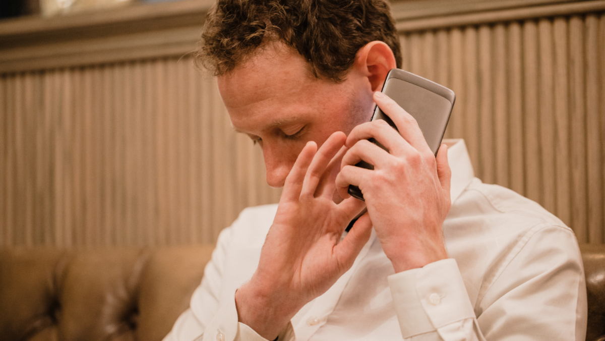 Man using touch screen phone to ear
