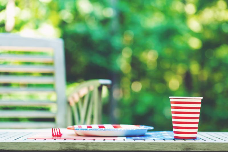 Fourth of July party table setting with plate and cup outside