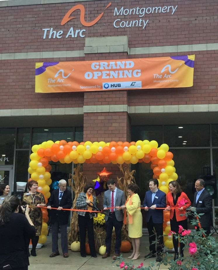 The cutting of the ribbon outside The Arc Montgomery County's new office.