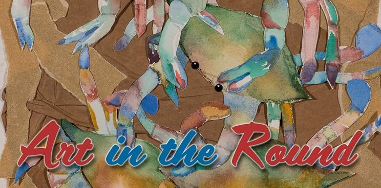 An artpiece featuring painted Maryland Blue Crabs with Art in the Round written over top.