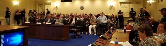Advocates crowded into the Maryland House of Delegates HGO Committee Room listening to testimony on Participant Choice and Control of Services for people with I/DD.