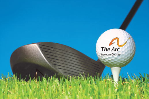 A golf club hitting a golf ball with The Arc Howard County's logo on it.