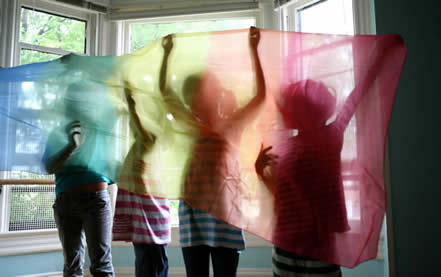 Kids by window with scarf