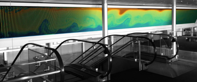 Bray's 1000 Years display showing ocean upwelling and downwelling on an 80-ft LED screen with swirling blues, greens, yellows, and reds.