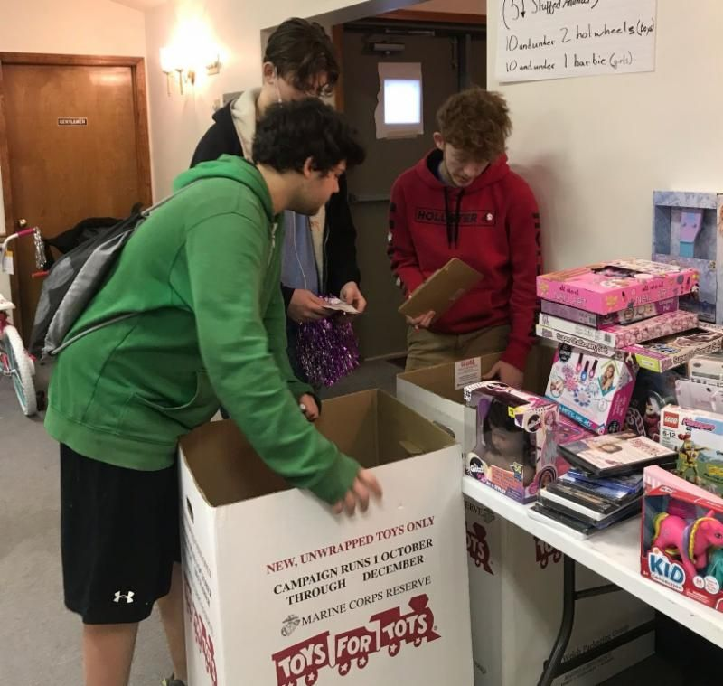 Photo of students helping select presents for Toys for Tots families.