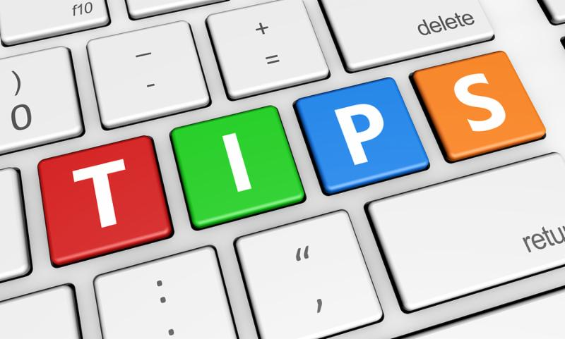 Tips and tricks concept with tips sign and letters on a colorful laptop computer keyboard 3d illustration for blog and online business.