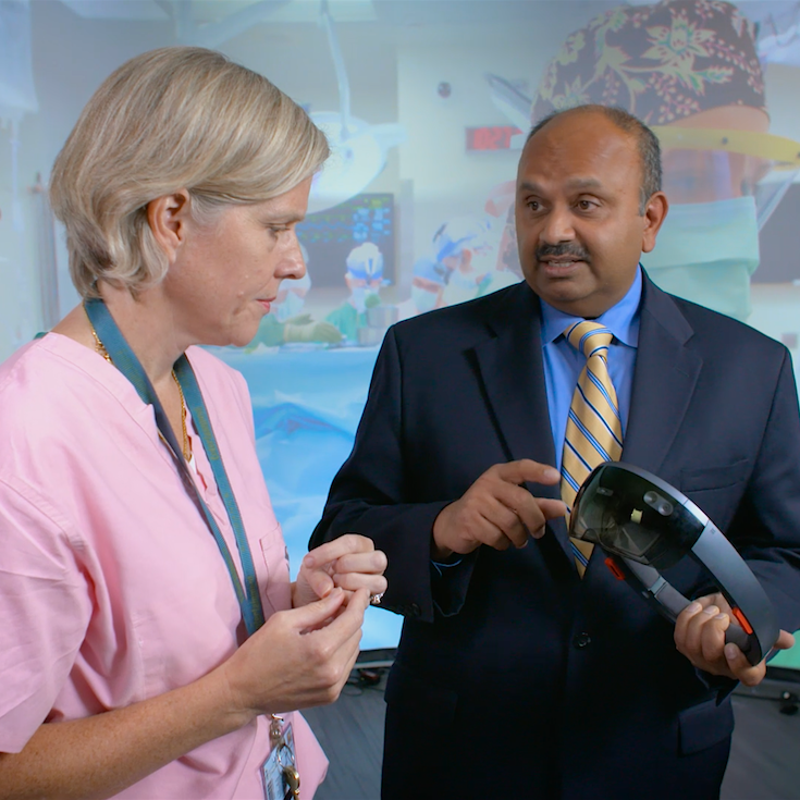 Dr. Murthi and Dean Varshney collaborate on augmented reality.