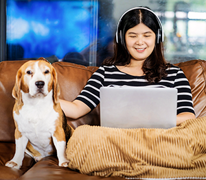 Woman and dog with computer