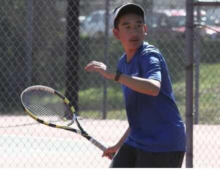 Dan Truong Playing Tennis