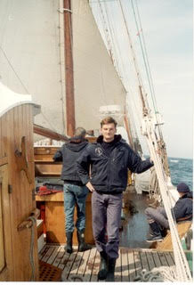 Olivier Lauzeral as a young man on the deck of a classic schooner.