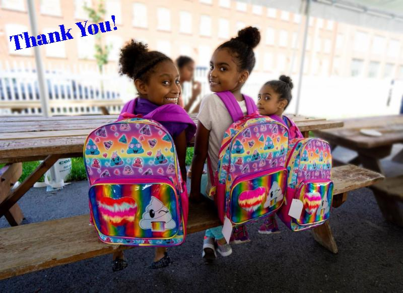 Children at SAC with their new backpacks donated by Aubuchon family!