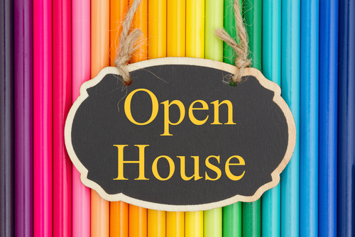 Open House text on a chalkboard with colorful pencil crayons