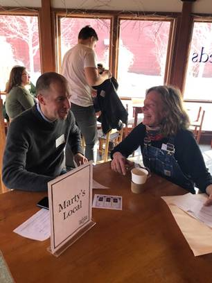 Farmer Beatrice Berle from Berle Farm in Hoosick, NY, meets with Nick Martinelli of Marty's Local at the Annual Networking Event. Buyers and growers could meet with up to six people for 10 minutes each to promote their products.
