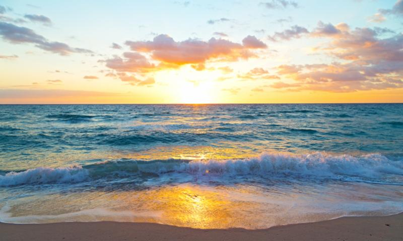Photo of a sunrise over the ocean
