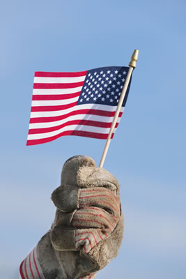 Photo of a work glove holding an American flag