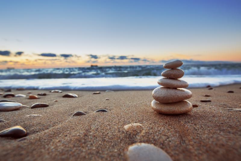 Photo of stones balanced on the beach