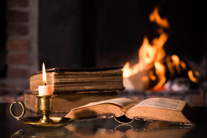 Book and candle by the fire