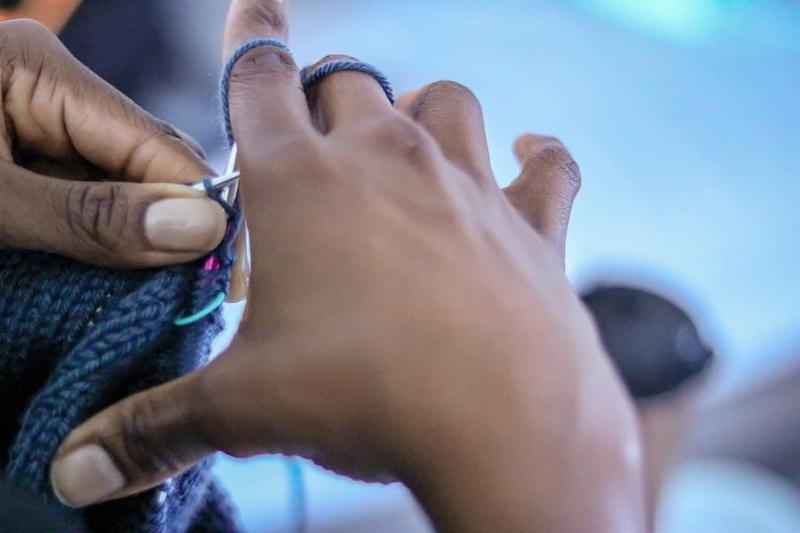 Photo of hands knitting