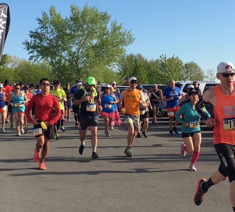 Several people running in the Battle Born Trail Series Fire Up for Firefighters Multi-Hour Event at Bartley Ranch.