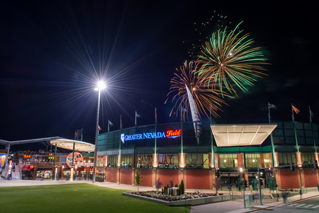 Greater Nevada Field arena at night with fireworks above.