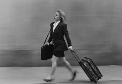 woman-walking-luggage.jpg