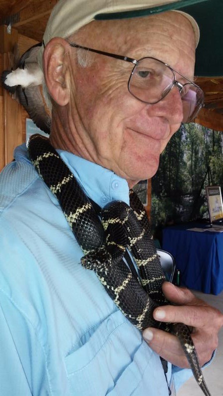Lee Hesler holding a king snake