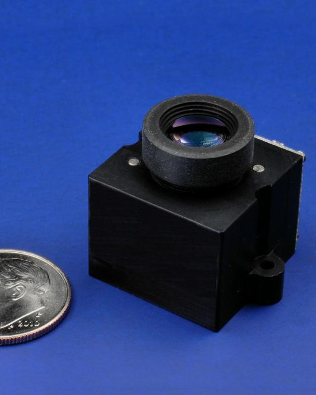 PHOTO - LENS MOTION SYSTEM WITH EMBEDDED CONTROLLER