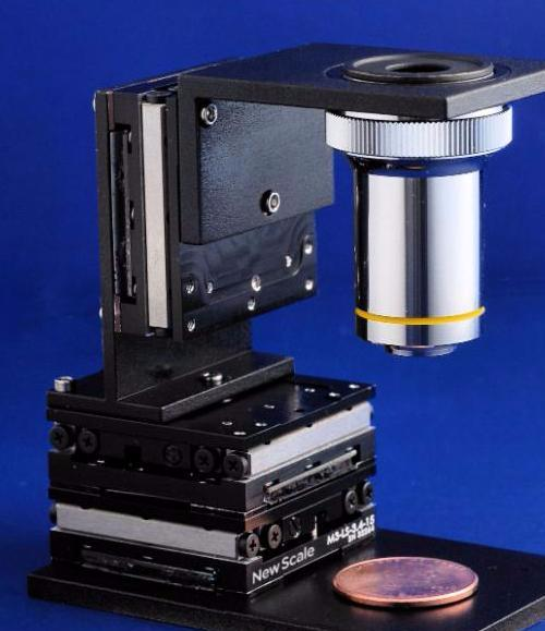 PHOTO - Microstage with built-in controller for moving a microscope objective